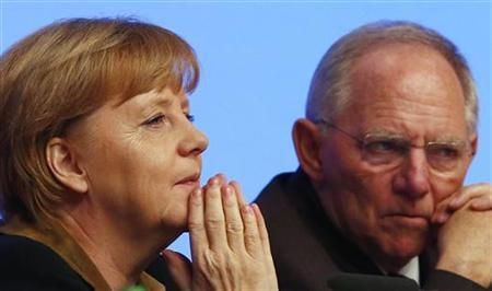 German Chancellor and leader of Germany's Christian Democratic Union (CDU), Angela Merkel (L ) talks to party fellow and Finance Minister Wolfgang Schaeuble during the CDU's annual party meeting in Hanover, December 4, 2012. REUTERS/Kai Pfaffenbach