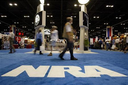 People walk inside the Orlando Convention Center at the 132nd Annual National Rifle Association Meeting in in Orlando, Florida April 27, 2003. REUTERS/Shannon Stapleton