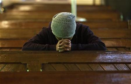 A worshipper prays at a Catholic church during Christmas celebrations in Srinagar December 25, 2012. REUTERS/Danish Ismail