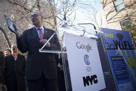 New York Senator Charles Schumer holds up his tablet at an announcement of neighborhood WiFi in New York January 8, 2013. REUTERS/Andrew Kelly