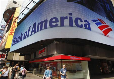 Tourists walk past a Bank of America banking center in Times Square in New York in this June 22, 2012 file photograph. REUTERS/Brendan McDermid/Files