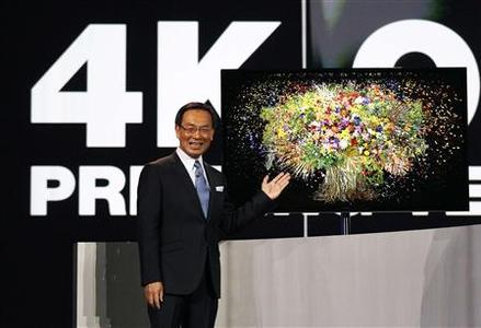 Panasonic chief Kazuhiro Tsuga introduces the company's new 4K OLED 56'' television during the Panasonic opening day keynote at the Consumer Electronics Show (CES) in Las Vegas January 8, 2013. REUTERS/Rick Wilking (UNITED STATES - Tags: BUSINESS SCIENCE TECHNOLOGY)