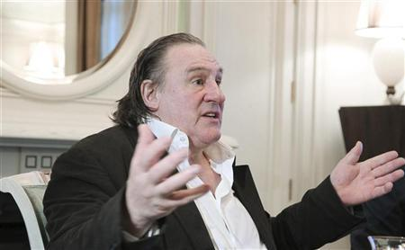 French actor Gerard Depardieu gestures during his meeting with Russian President Vladimir Putin in Sochi January 5, 2013. REUTERS/Mikhail Klimentyev/RIA Novosti/Pool