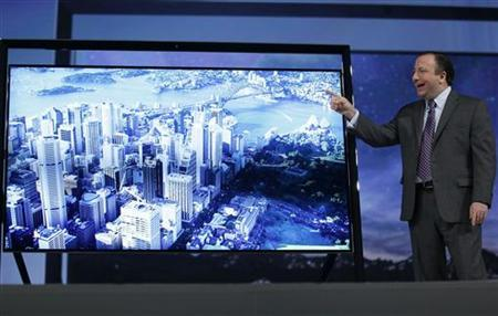 Joe Stinziano, executive vice-president for Samsung Electronics America debuts the company's new 85'' Ultra High Definition television at the Samsung news conference at the Consumer Electronics Show (CES) in Las Vegas January 7, 2013. REUTERS/Rick Wilking