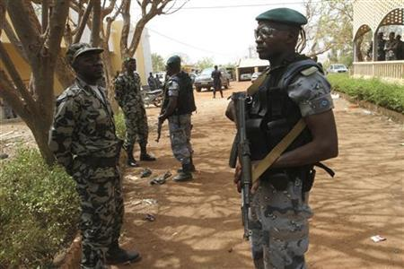 Malian soldiers stand in guard in Kati, outside Bamako March 30, 2012. REUTERS/Luc Gnago