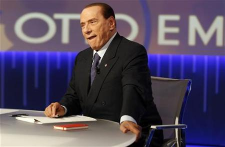 Former Italian Prime Minister Silvio Berlusconi sits before the taping of the talk show ''Otto e mezzo'' (Eight and a half) at La7 television in Rome January 8, 2013. REUTERS/Remo