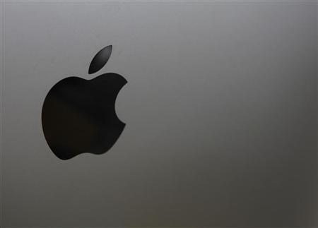 The logo of Apple is seen on a product displayed at a store in Seoul August 24, 2012. REUTERS/Lee Jae-Won