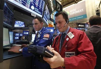 Wall Street slips as earnings season gets under way