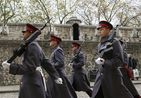 Soldiers march at the Tower of London in central London November 13, 2012. REUTERS/Olivia Harris