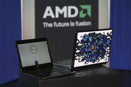 A Hewlett-Packard Pavilion dv2 laptop with an AMD Yukon platform (L) is shown next to a laptop displaying the ''Engine Room'' Notebook Design Contest winning design during an Industry Insider session on the first day of the 2009 International Consumer Electronics Show (CES) in Las Vegas, Nevada, January 8, 2009. REUTERS/Steve Marcus