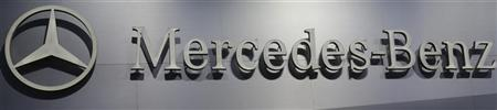 A logo is seen on the Mercedes-Benz booth on media day at the Paris Mondial de l'Automobile September 27, 2012. REUTERS/Jacky Naegelen