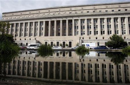 The U.S. Interior Department building is shown reflected in a pond in Washington, September 10, 2008. REUTERS/Jason Reed