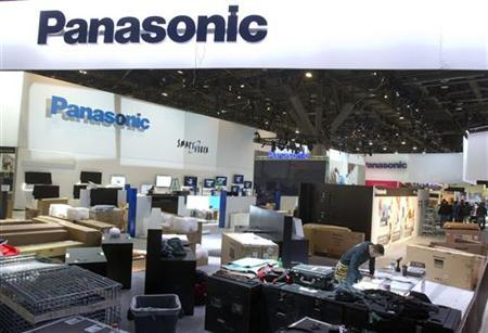Workers prepare the Panasonic booth for the International CES show at the Las Vegas Convention Center in Las Vegas, Nevada January 4, 2013. REUTERS/Steve Marcus