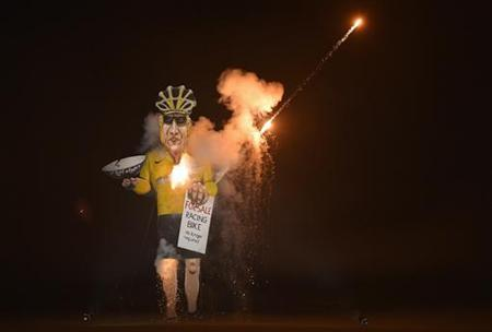 An effigy of U.S. cyclist Lance Armstrong burns during Bonfire Night celebrations in Edenbridge, south east England November 3, 2012. REUTERS/Toby Melville/Files
