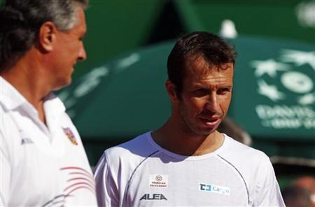 Radek Stepanek (R) of Czech Republic talks to team captain Jaroslav Navratil during a training session in Buenos Aires September 12, 2012. REUTERS/Marcos Brindicci/Files