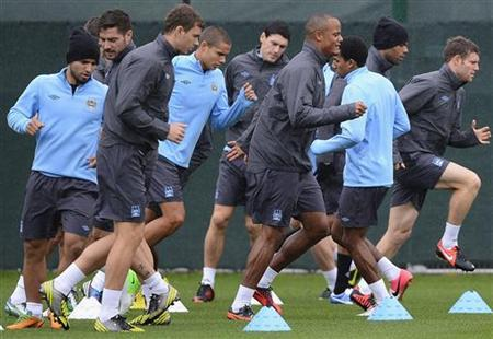 Manchester City's players run during a practice session at the club's Carrington training complex in Manchester October 2, 2012. REUTERS/Nigel Roddis/Files