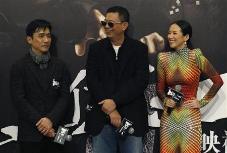 Hong Kong director Wong Kar Wai (C),actor Tony Leung (L) and Chinese actress Zhang Ziyi attend at the premiere of the movie ''The Grandmaster'' in Hong Kong January 8, 2013. REUTERS/Tyrone Siu