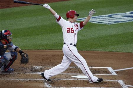 Washington Nationals' Adam LaRoche hits a solo home run against the St. Louis Cardinals during the second inning in Game 4 of their MLB NLDS baseball series in Washington October 11, 2012. REUTERS/Jonathan Ernst