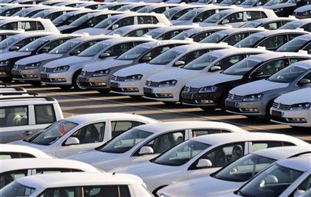 New Volkswagen cars are seen in a vehicle parking space in the port of Koper November 16, 2012. REUTERS/Srdjan Zivulovic/Files