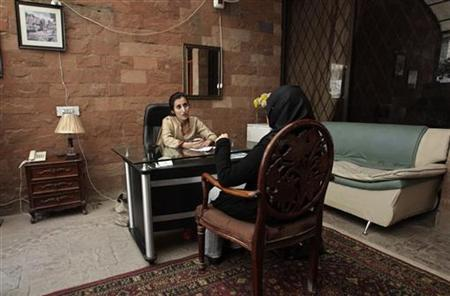 Maryam Suheyl, a marriage and family therapist, meets her client to discuss marital issues at her office in Lahore December 26, 2012. REUTERS/Mohsin Raza
