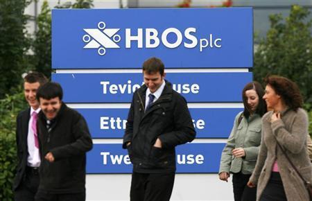Pedestrians walk past an HBOS sign outside the company buildings, in Edinburgh, Scotland on September 18, 2008. REUTERS/David Moir