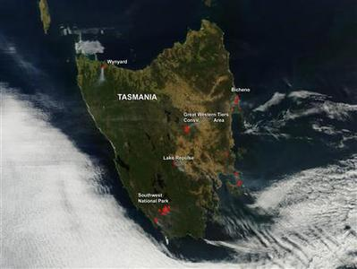 View from the Terra satellite shows fires burning in Tasmania in this NASA handout image dated January 6, 2013. REUTERS/NASA/Handout