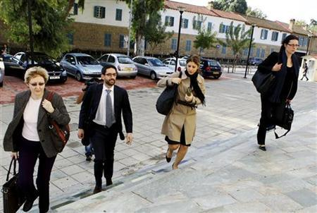 Representatives of the European Central Bank, International Monetary Fund and the European Commission arrive at Cyprus's finance ministry, where the third round of bailout talks were held, in Nicosia November 9, 2012. REUTERS/Andreas Manolis
