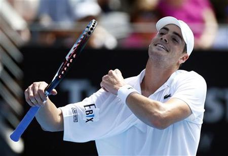John Isner of U.S. reacts during his men's singles match against compatriot Ryan Harrison at the Sydney International tennis tournament January 9, 2013. REUTERS/Daniel Munoz