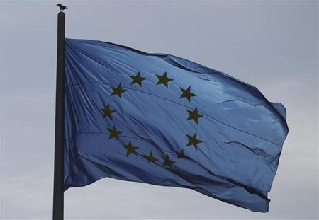 The EU flag is pictured atop the Reichstag building in Berlin, October 12, 2012. REUTERS/Tobias Schwarz