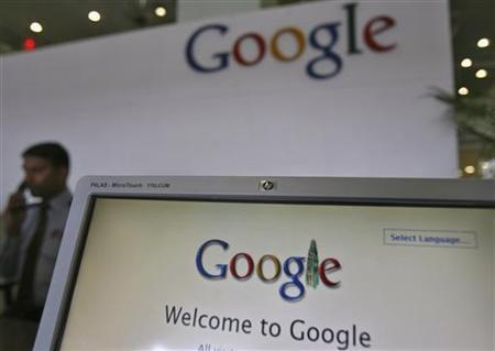A security personnel answers a call at the reception counter of the Google office in the southern Indian city of Hyderabad February 6, 2012. REUTERS/Krishnendu Halder