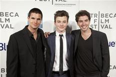 "Actors Robbie Amell (L), Chris Colfer (C) and Roberto Aguire arrive for the world premiere of ""Struck by Lightning"" as part of the Tribeca Film Festival in New York April 21, 2012. REUTERS/Andrew Kelly"