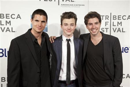 Actors Robbie Amell (L), Chris Colfer (C) and Roberto Aguire arrive for the world premiere of ''Struck by Lightning'' as part of the Tribeca Film Festival in New York April 21, 2012. REUTERS/Andrew Kelly