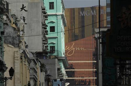 The Wynn Macau and MGM Grand Macau resorts are seen in between buildings in Macau June 5, 2012. REUTERS/Bobby Yip