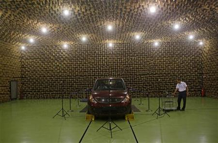 An engineer works inside the noise testing chamber at Tata Motors plant in Pimpri, 160 km (99 miles) southeast of Mumbai, December 14, 2012. REUTERS/Danish Siddiqui/Files