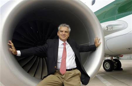 Paulo Cesar de Souza e Silva, Embraer President Commercial Aviation poses for the photographers after a news conference for the presentation of new Alitalia jet '' Embraer E-jet 190'' at Leonardo da Vinci airport in Fiumicino, October 6, 2011. REUTERS/Remo Casilli