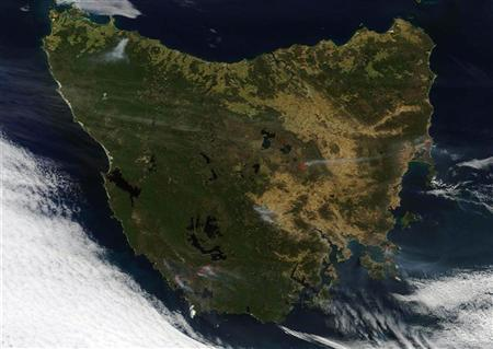 View from the Terra satellite shows fires burning in Tasmania in this NASA handout image dated January 7, 2013. Image taken January 7, 2013. REUTERS/NASA/Handout