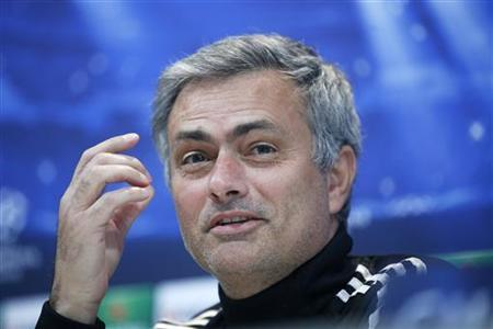 Real Madrid coach Jose Mourinho laughs during a news conference outside Madrid December 3, 2012. REUTERS/Andrea Comas/Files