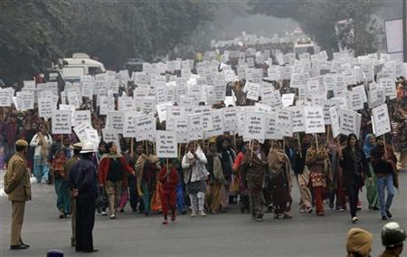 Women hold placards as they march during a rally organized by Delhi Chief Minister Sheila Dikshit (unseen) protesting for justice and security for women, in New Delhi January 2, 2013. REUTERS/Adnan Abidi