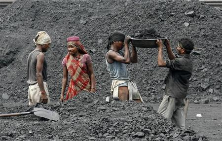 Laborers work in a railway coal yard on the outskirts of Ahmedabad June 15, 2010. REUTERS/Amit Dave