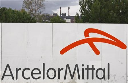 The logo of the ArcelorMittal's steel plant is seen on the site of Fos-sur-Mer near Marseille, South eastern France, November 5, 2008. REUTERS/Jean-Paul Pelissier/Files
