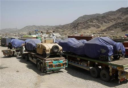 Trucks carrying supplies for NATO troops cross into Afghanistan from Pakistan at the Tor kham July 28, 2012. REUTERS/Parwiz