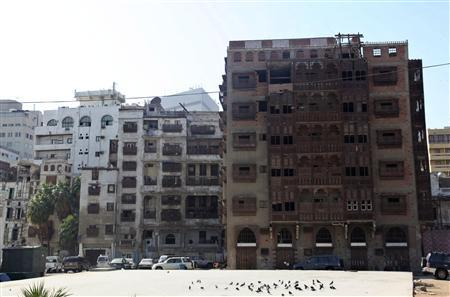 A general view shows historical buildings in Jeddah's historic district January 1,2013. In the heart of Saudi Arabia's sprawling Red Sea port city of Jeddah, centuries-old buildings tilt and buckle above the historic district's narrow alleys, withering away in the absence of decisive action to protect them. But while Jeddah is building the world's tallest tower as part of a modernisation drive, efforts to preserve its oldest area are faltering. Restoration efforts have been left largely in private hands because Saudi authorities cannot by law intervene to renovate the privately owned homes in the district. Picture taken January 1, 2013. REUTERS/Susan Baaghil