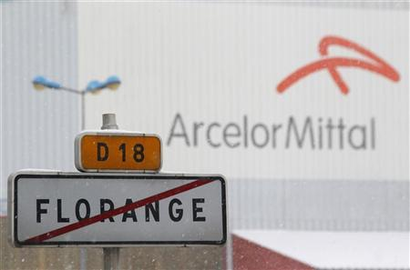 A road sign with the crossed out city name of Florange is seen in front of the ArcelorMittal plant in Florange, Eastern France, December 3, 2012. REUTERS/Vincent Kessler