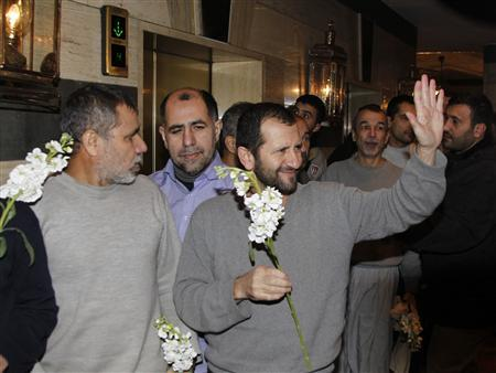 Iranians released by Syrian rebels arrive at a hotel in Damascus January 9, 2013. Forty eight Iranians released by Syrian rebels in exchange for the release of more than 2,000 civilian prisoners held by the Syrian government arrived at the Sheraton hotel in central Damascus on Wednesday, a Reuters witness said. The men were accompanied by the Iranian ambassador to Syria and arrived in six small buses, looking tired but in good health. REUTERS/Khaled al-Hariri