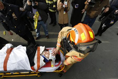 A victim of a commuter ferry crash is cared for by an FDNY EMT on the scene in New York, January 9, 2013. REUTERS/Brendan McDermid