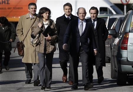 Eleni Papaconstantinou, cousin of former Greek Financial Minister George Papaconstantinou, (front L) is escorted by her lawyer Giorgos Stefanakis (front R), her husband Simeon Sikiaridis (back R), the husband of Eleni's sister Andreas Rossonis (back C) and an unknown man (back L) arrive to testify to Greece's financial crimes prosecutor in Athens January 9, 2013. Greece's parliament is expected to vote as early as next week on whether to probe Papaconstantinou and his successor as finance minister, Evangelos Venizelos, after prosecutors found that names of Papaconstantinou's relatives had been deleted from a list of possible tax cheats he handled when in office. REUTERS/John Kolesidis