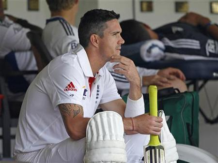 England's Kevin Pietersen looks on from the dressing room during the second day of the warm-up game against the India A cricket team in Mumbai October 31, 2012. REUTERS/Danish Siddiqui/Files