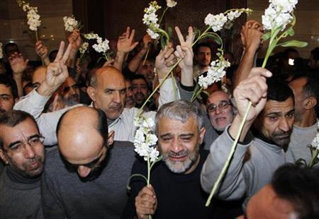 Iranians released by Syrian rebels arrive at a hotel in Damascus January 9, 2013. REUTERS/Khaled al-Hariri