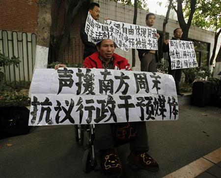 A supporter of Southern Weekly in a wheelchair demonstrates outside the office of the liberal newspaper in the southern Chinese city of Guangzhou January 9, 2013. The Communist Party chief of Guangdong province stepped in to mediate a standoff over censorship at a Chinese newspaper on Tuesday, a source said, in a potentially encouraging sign for press freedoms in China. Chinese characters on the banner reads ''Support Southern Weekly. Protest again intervention on media. Defend press freedom''. REUTERS/Bobby Yip