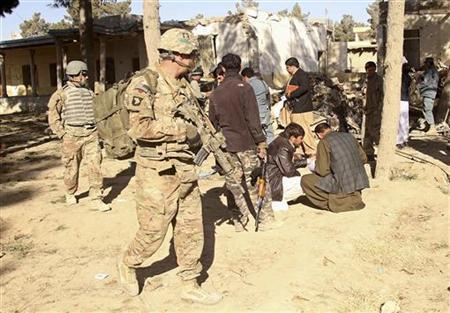 NATO and Afghan forces inspect at the site of suicide attack in Spin Boldak district of Kandahar province January 6, 2013. REUTERS/Ahmad Nadeem